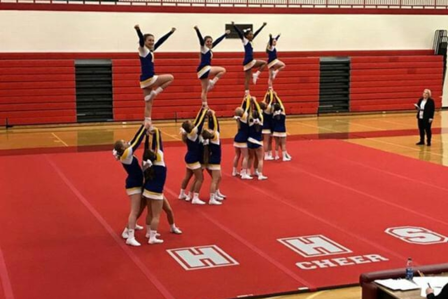 The cheer team performed one of its routines at a league competition Wednesday, Jan. 9, at Holly.
