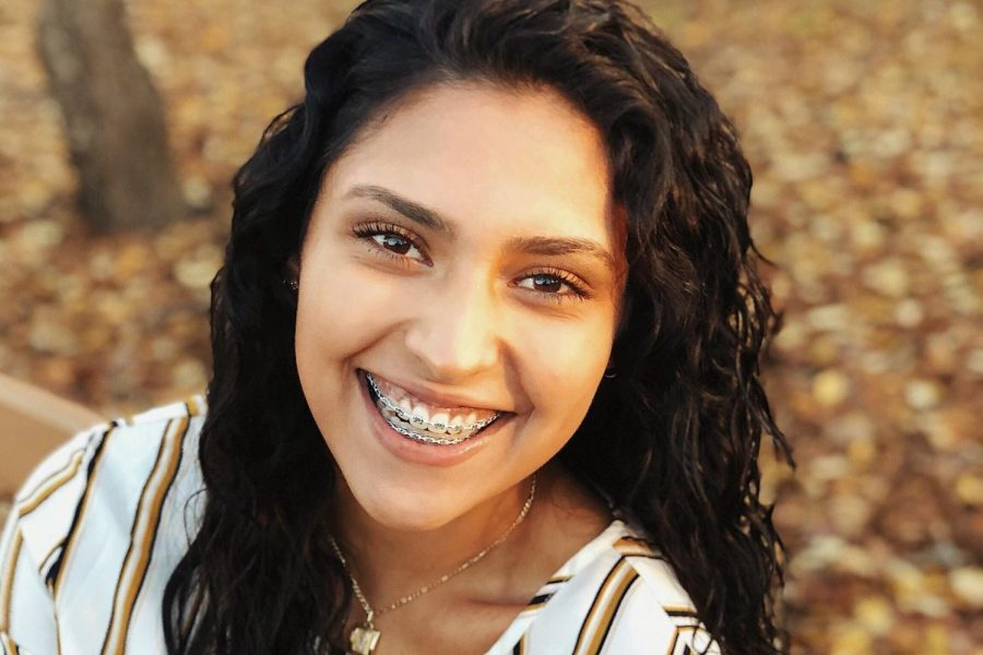 Senior Mariana Arambula smiles during a photo shoot for her senior pictures at For-Mar Nature Preserve.