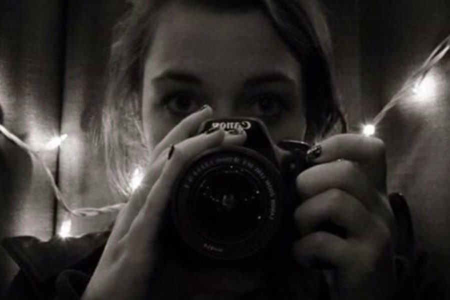 Sophomore Mackenzie Atkinson photographs herself as a way to represent her passion for photography.