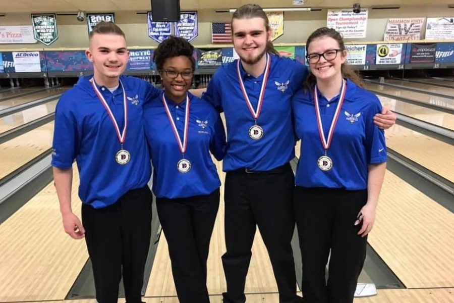 Juniors Lawson Boshaw (l to r) and Imari Blond defeated juniors Ethan Burke and Samantha Timm in the final during the Davison Mixed Doubles Tournament on Sunday, Dec. 30.