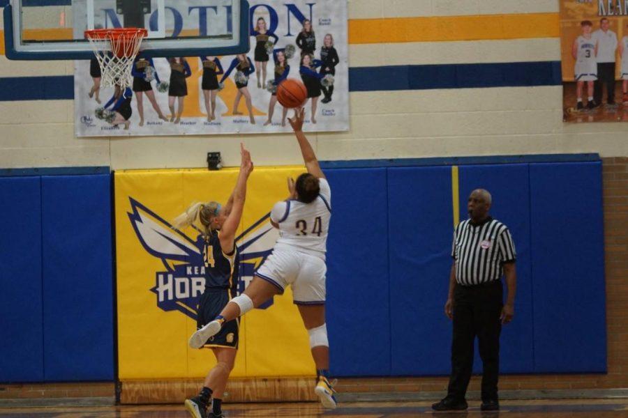 Senior Mackenzie Ramey goes for a two-pointer on Friday, Feb. 15.