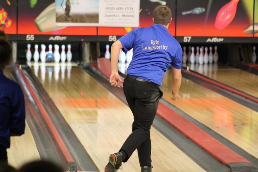 Senior Kyle Langworthy watches as his ball hits the pins against Clio on Monday, Feb. 11.