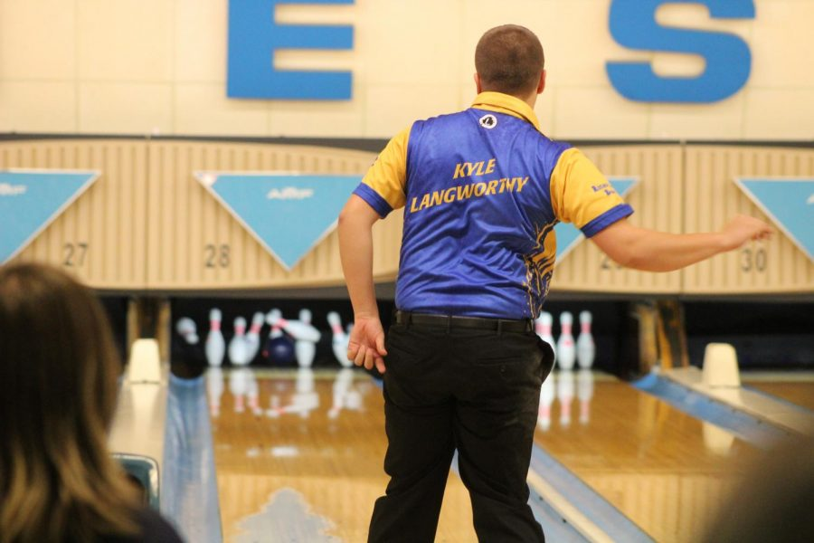 As his bowling ball makes contact with the pins, senior Kyle Langworthy watches the outcome of his shot. Langworthy will compete in the MHSAA Division 2 final in Waterford on