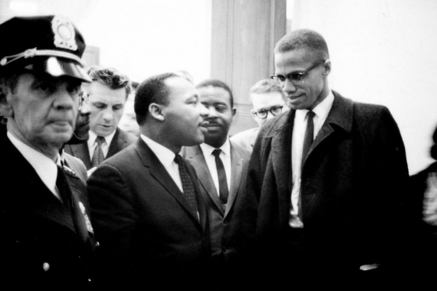 Malcom X (right) and the rev. Dr. Martin Luther King, Jr. (center) meet before a press conference. Both men had come to hear the Senate debate on the Civil Rights Act of 1964. This was the only time the two men ever met. Their meeting lasted only one minute.