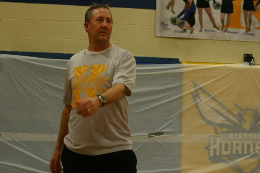 Mr.+Andy+Nester+watches+his+serve.+Nester+played+for+the+faculty+team+that+took+on+the+Senior+Class+in+a+volleyball+match+during+the+snowcoming+pep+assembly.