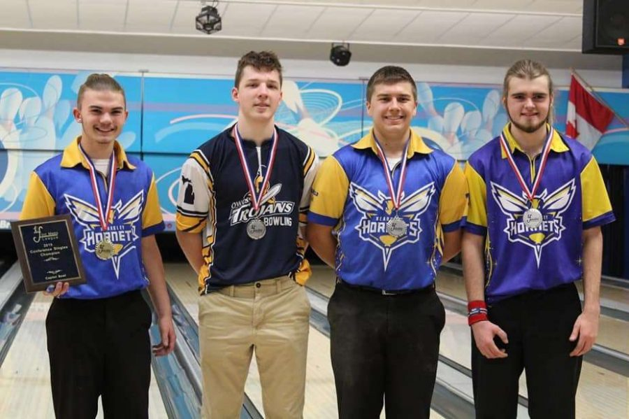 Junior Lawson Boshaw (l to r), an Owosso bowler, senior Kyle Langworthy, and junior Ethan Burke placed first place through fourth place, respectively, in the Metro League Singles Tournament on Saturday, Feb. 16.