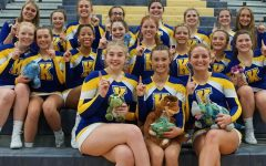 Competitive cheer tumbles to first