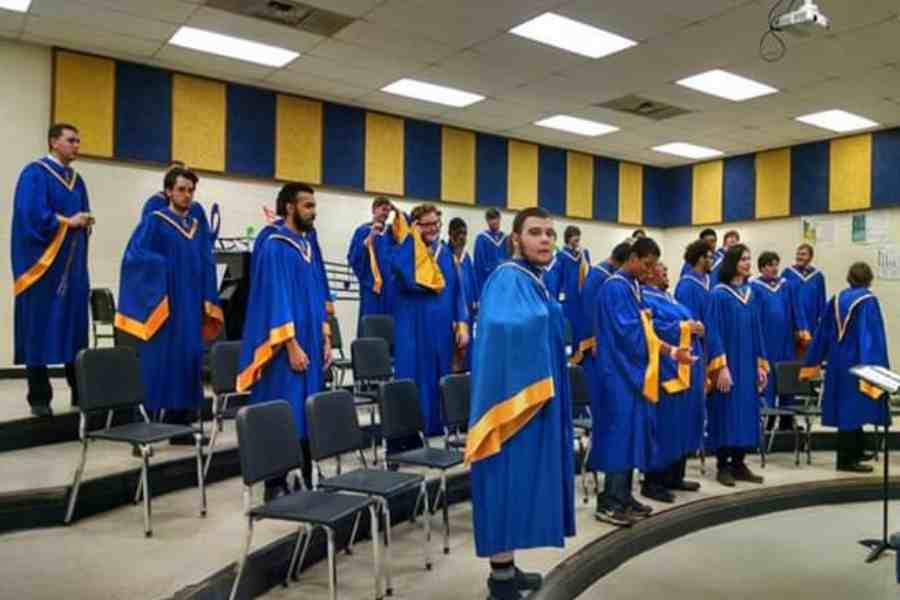 The Men's Chorus warms up before performing at the spring concert on Thursday, March 21.