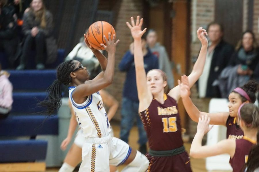 Junior Sydney Walker shoots on Monday, March 4, in a game against Davison.