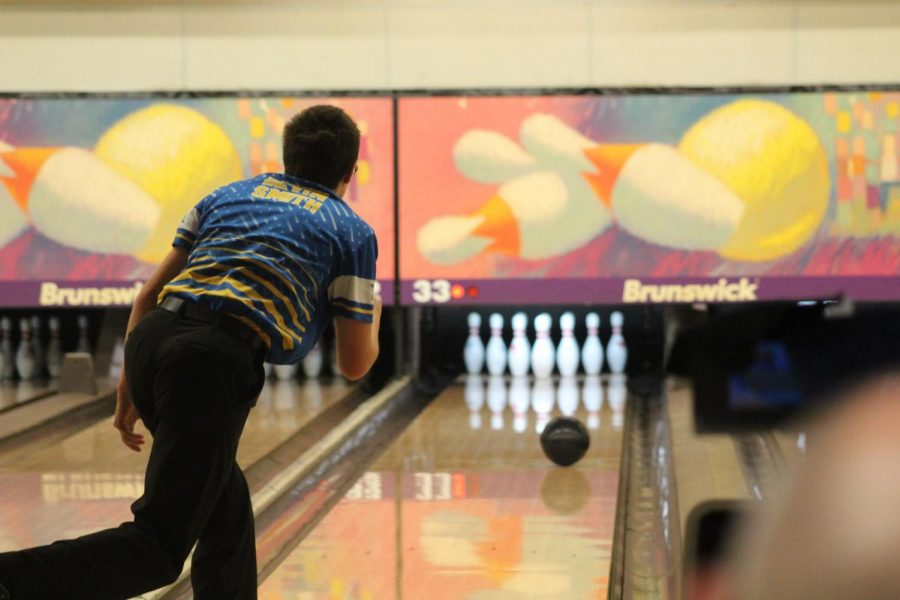 Senior Devin Smith locks eyes on his ball as it glides down the lane in the MHSAA Division 2 team final on Friday, March 1.