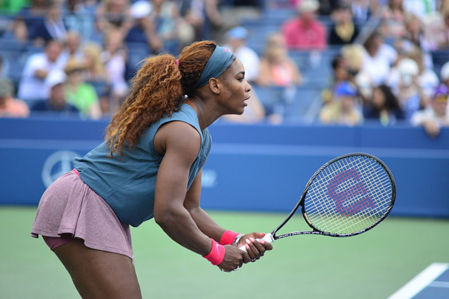 Serena Williams plays in doubles action during the 2013 U.S. Open. Williams speaks out against sexism in tennis.