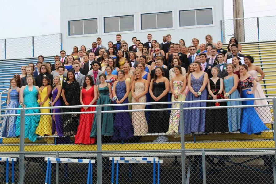 The Class of 2019 smiles for its prom photo.
