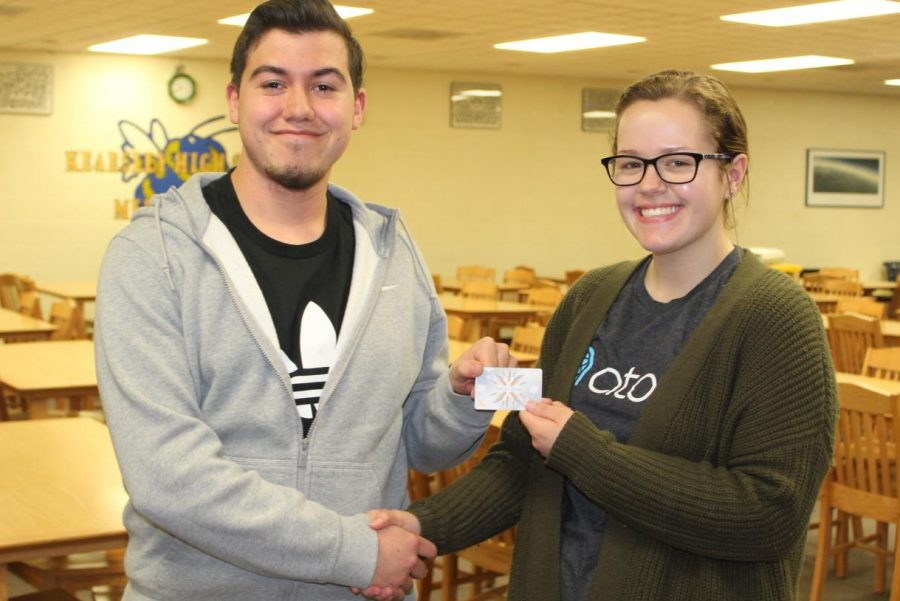 Senior Artie Emmendorfer (left) took second place in the Eclipse March Madness Challenge and received a $5 gift card to a local restaurant, which was presented to him by The Eclipse editor in chief Jenna Robinson.