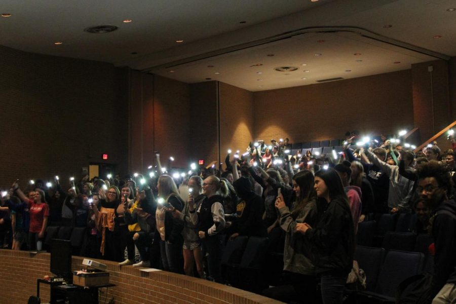 Sophomores and seniors wave their phone flashlights in the air to The Reminders' music. The singing duo performed Friday, April 26.