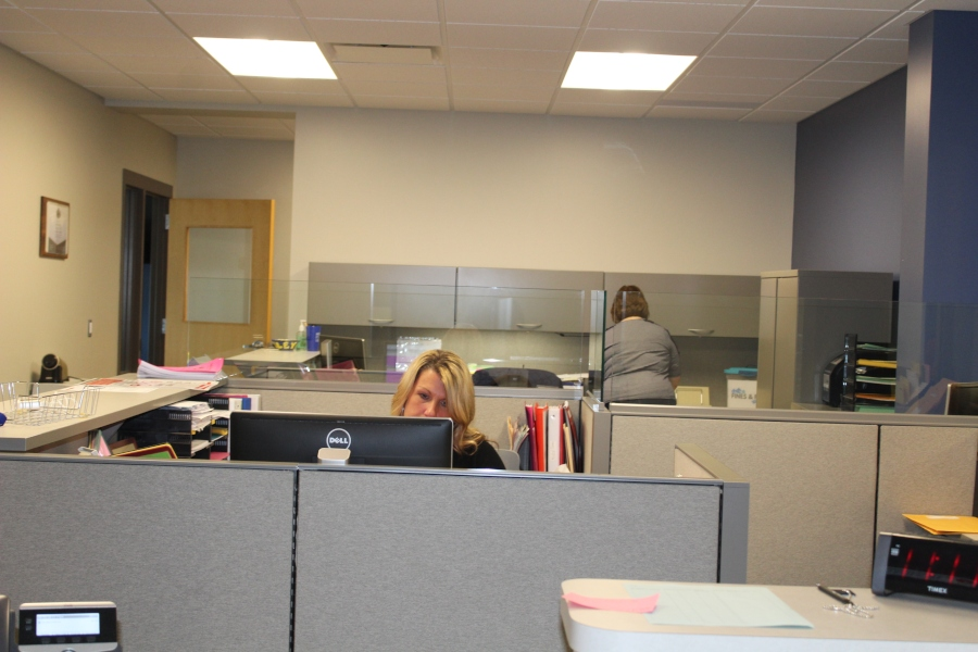 Mrs. Angie Arye (front) and Mrs. Sue Murray are busy at work making the office run smoothly.