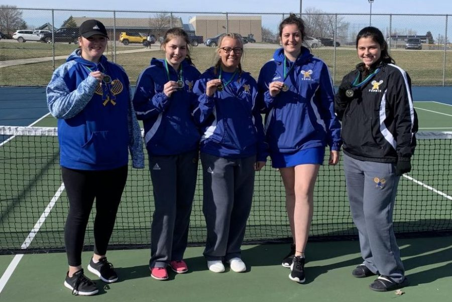 The Hornets pose with their medals after falling short of first by one point, finishing with 14 points at the Lapeer Lightning Quad on Saturday, April 13.