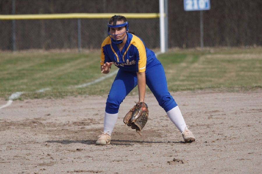 Senior+Jacee+Sword+plays+third+base+in+a+non-league+game+against+Powers+Catholic+on+Friday%2C+April+12.+The+softball+team+was+victorious+against+the+Chargers+in+both+games+of+a+doubleheader..