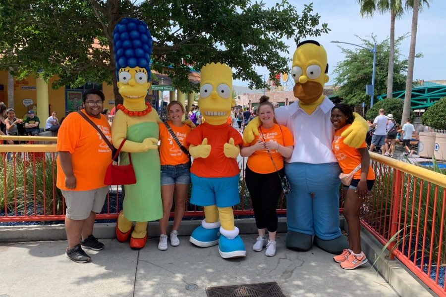 Seniors (left to right) Niccos Patrick, Chloe Clarambeau, Mary Wheeler, and Robrianna Weatherspoon pose with The Simpson characters during their trip to Orlando