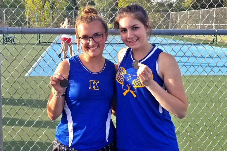 Seniors Chloe Clarambeau (left) and Valerie Entenmann celebrate earning All-League honors at the Metro league tennis championship Wednesday, May 22.