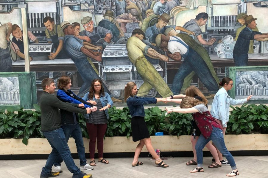 Foreign language students pose to copy a mural at the Detroit Institute of Arts on Wednesday, May 1.