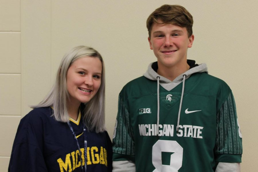 Sophomores Madison Horner (left) and Kaleb Gettings wear Michigan and Michigan State spirit wear in the cafeteria Monday, Oct. 7.