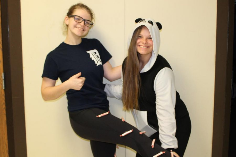 "Junior Megan Timm (l) is a ""smarty pants"" and senior Shelby Cranmer (r) wears her panda onesie."