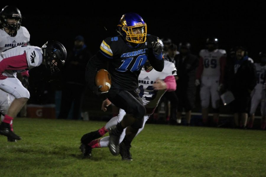 Sophomore Derrick Phipps (No. 10) sprints downfield after catching a pass from junior Braylon Silvas in a football game against Royal Oak Friday, Oct. 25.