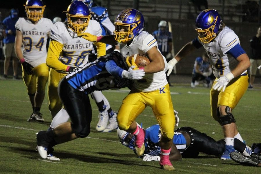 Junior Isaiah Stiverson (center) carries the ball as a Brandon linebacker goes in for the tackle in a game against the Blackhawks Friday, Oct. 18. Kearsley lost 38-26.
