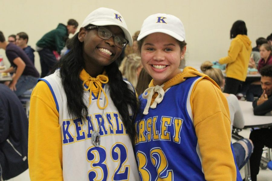 Seniors Sydney Walker and Stacia Tipton dressed in jerseys and hats for Twin Tuesday, posing together for a photo in the cafeteria Tuesday, Oct. 8.