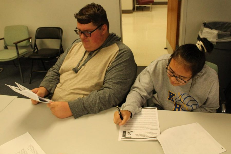 Sophomores Gage Slagor (left) and Aizya Sorensen research international travel in Future Problem Solving practice Friday, Oct. 18, at the administration building.