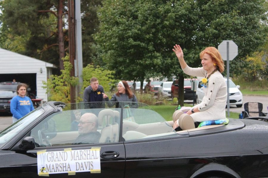 Mrs. Marsha Davis waves as she leads the 2019 homecoming parade Friday, Oct. 11. She retired from Kearsley in 2011 after decades in the district.