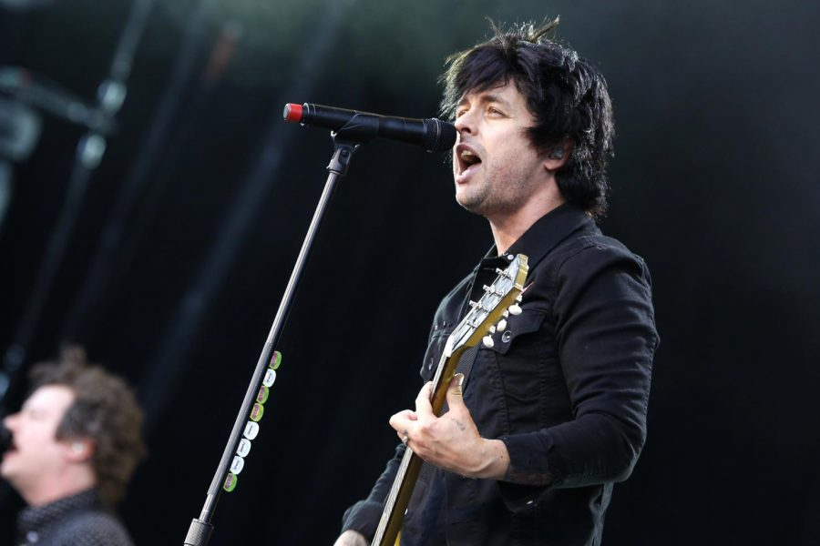 Billie Joe Armstrong sings during a Green Day performance. The band released two singles for its upcoming album.