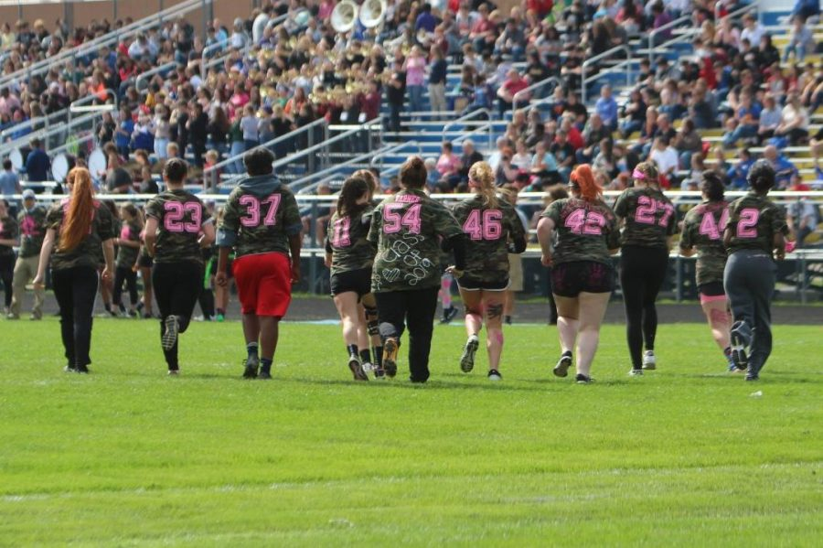 The Class of 2019 takes the field during the 2018 powder puff tournament.