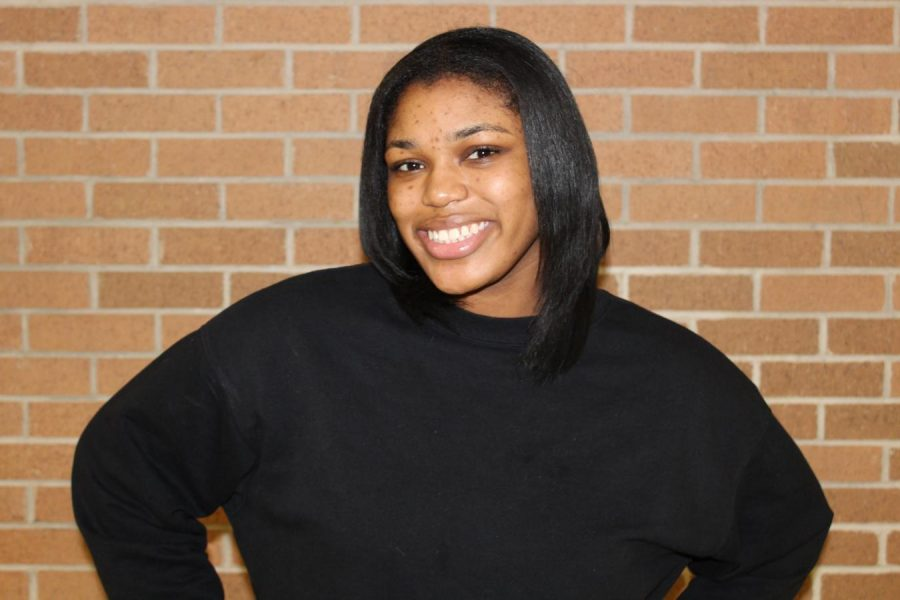 Senior Yasmin Brown enjoys playing tennis and volunteering with her youth group.