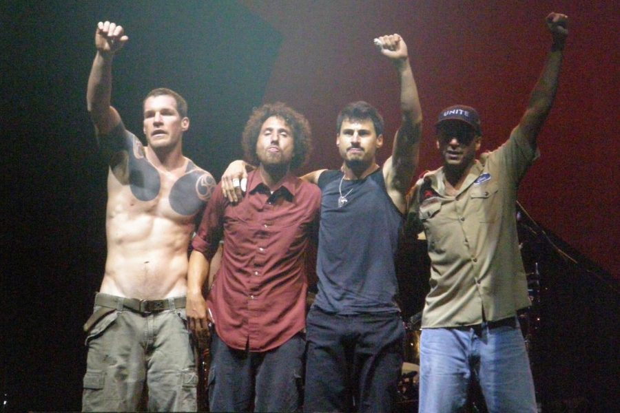 Rage Against the Machine holds up power fists at the end of a reunion performance in 2007.