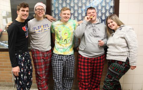 Seniors Trenton DiGenova, Brandon Fisher, Ashtyn Cohoon, Gabe Mosher and Maddy Alpin wear their Christmas pajamas in celebration of the upcoming winter break on Friday, Dec. 20.