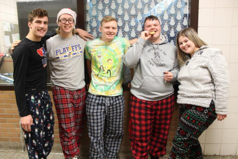 Students wear their ugly sweaters with pride