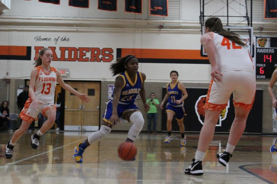 Senior JaKiera Wash cuts up the middle of the court during a game against Flushing Friday, Dec.13.