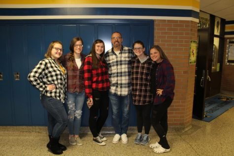 (From Left) Juniors Katie Davidson, Allyson Link, Alayna Roster, Mr. Chris Torok, Megan Timm, and senior Shelby Cranmer pose with various types of flannels on Flannel Day.