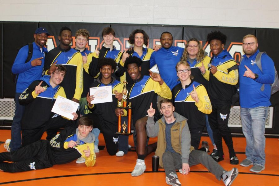 The+wrestling+team+poses+with+its+first+place+trophy+and+accompanying+medals+at+the+Tri-County+Clash+in+Clio+Saturday%2C+Dec.+21.