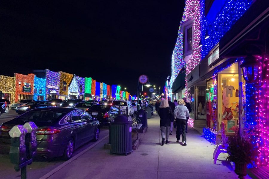 Shoppers walk down Main Street in Rochester during the
