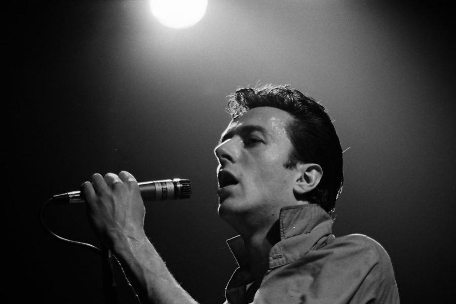 The Clash's front man, Joe Strummer, performs