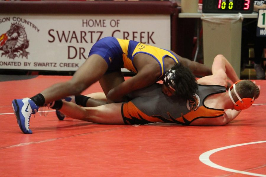 Junior Rodney Richards (top) attempts to turn his opponent for a pin in a wrestling meet at Swartz Creek Wednesday, Jan. 15.