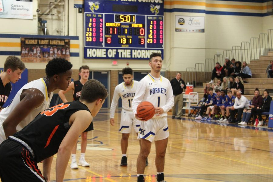 Junior Braylon Silvas (No. 1) gets ready to shoot a free throw at a boys basketball game against Fenton Friday, Jan. 10.