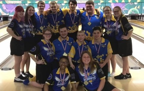 The girls and boys bowling teams pose together after their victories at the Metro Conference Tournament Saturday, Jan. 25.