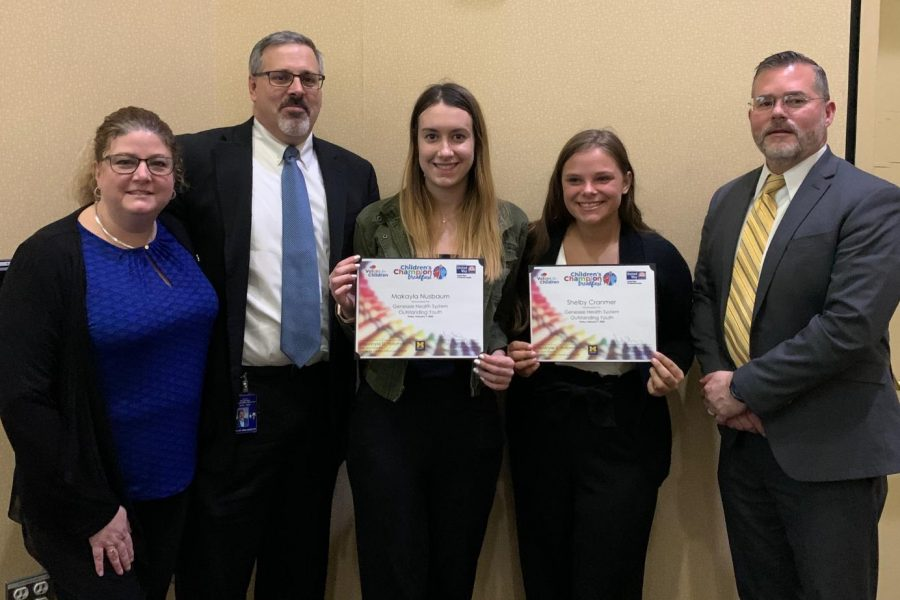 Mrs. Corrine Walworth, (l to r), Superintendent Kevin Walworth, senior Makayla Nusbaum, senior Shelby Cranmer, and Principal Brian Wiskur attended the Children's Champion Breakfast as Nusbaum and Cranmer received recognition for their charitable acts Friday, Feb. 7.