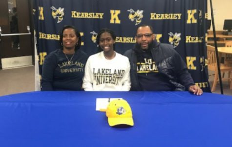 Senior Sydney Walker (center) poses with her parents after signing her National Letter of Intent to play basketball with Lakeland University Friday, Feb. 7.