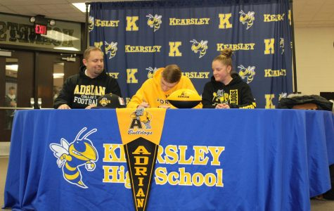 Senior Ethan Livingston (center) signed his National Letter of Intent to play football at Adrian College Friday, Jan. 31.