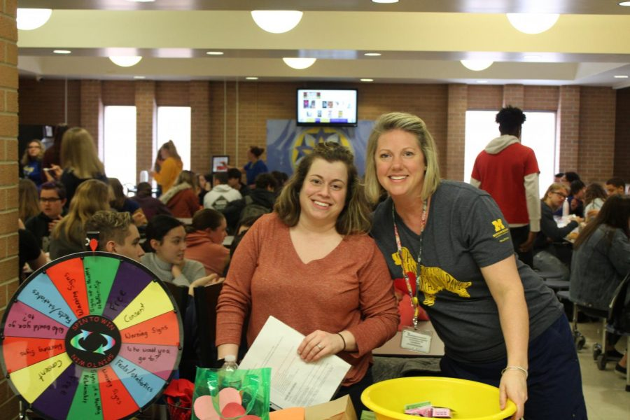 RAHS Clinic nurses (l to r) Stephanie Wambold and Andrea Rossnip stand in front of their display.