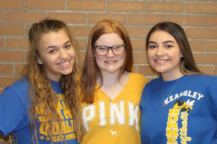 Sophomore Karlee Clarambeau (L to R) Freshman Lindsey Geeck, and Sophomore Cierra Riley posing in their spirit wear for spirit day.